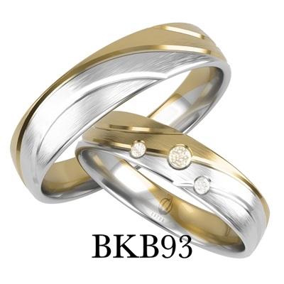 bizuteriakumor.pl obrączki złote bikolor łączone białe i żółte złoto profil lekko półokrągły łączone po fali trzy brylanty cyrkonie bkb93