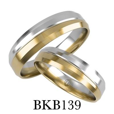 bizuteriakumor.pl obraczki24.com.pl para obrączek złotych dwa kolory żółte i białe złoto przedzielone paskiem i frezem jako odcięcie kolorów złoto 585 750 mocno fasetowane boki bkb139