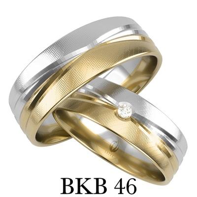 bizuteriakumor.plobraczki  obraczki24.com.pl para obrączek złotych prosty profil zdobienie frezem w kształcie kokardy w obrączce damskiej brylant lub cyrkonia BKB46