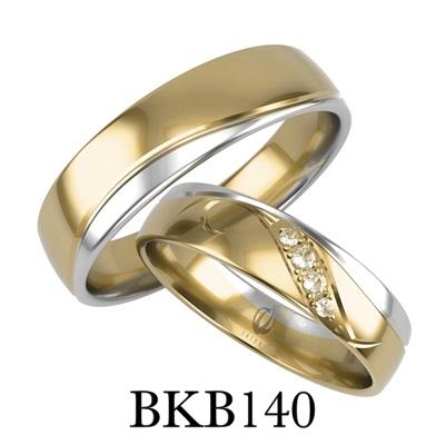 bizuteriakumor.pl obraczki24.com.pl para obrączek złotych z cyrkoniami z brylantami po fali dwa kolory żółte i białe złoto dzielone frezem jako odcięcie kolorów złoto 585 750 BKB140 1